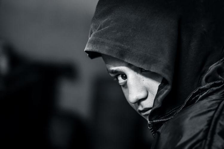 Close-Up Portrait Of Teenage Boy Wearing Hooded Shirt