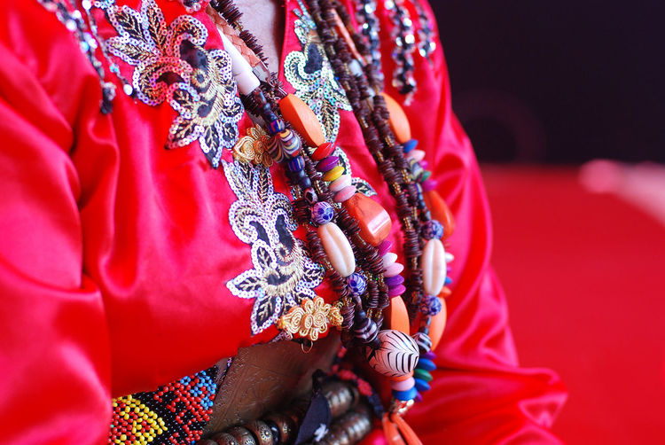 Beads worn by female shaman of the Tombonua etnicity of Sabah, Borneo, Malaysia. Attire Beads Bobohizan Close-up Costume Day Festival Harvest Human Body Part Human Hand Indoors  Kimono Malaysia Malaysia Truly Asia Midsection One Person People Real People Red Religion Sabah Shaman Tradition Traditional Clothing Women