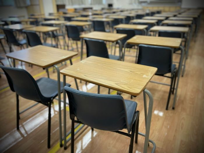 Empty chairs and table in classroom