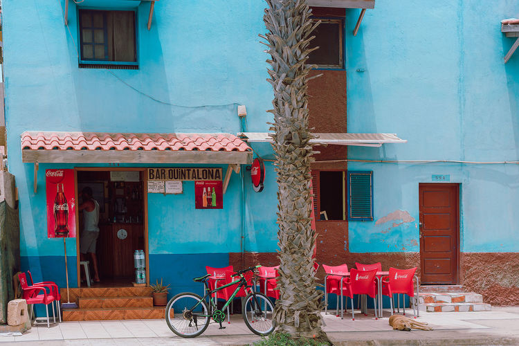 Cape Verde Cafe exterior Cape Verde Africa Architecture Awning Bicycle Blue Building Exterior Built Structure Cafe Day No People Outdoors Red Red Chairs