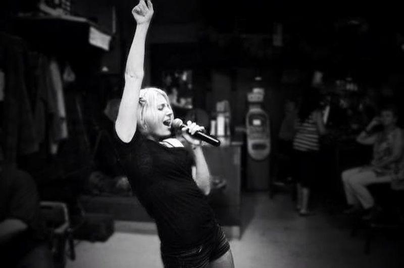Woman Singing At Restaurant
