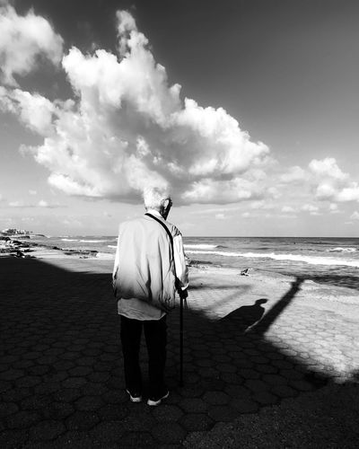 Black And White Friday Sea Beach Standing Water Horizon Over Water One Person Real People Full Length Rear View Sky Men Nature Tranquil Scene Sand Scenics Tranquility Outdoors מיישחורלבן Leisure Activity מייבתגלים מייים IPhone7Plus מייאייפון7 Shotoniphone7plus See The Light Shades Of Winter This Is Aging