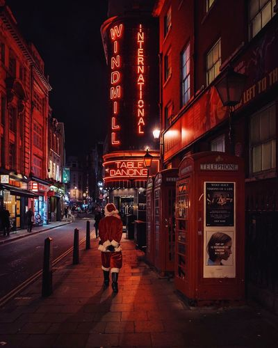 Santa Claus in Soho Night Illuminated Building Exterior Architecture Built Structure Street Real People Outdoors City Full Length Lifestyles Men Sky One Person Neon People Christmas Santa Santa Claus Father Christmas