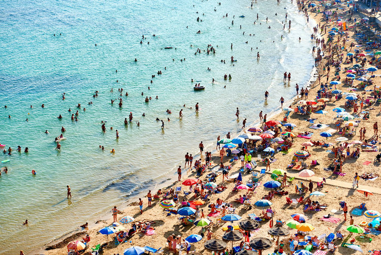 High angle view of crowd at beach in costa blanca