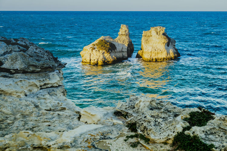 Two Sisters - Melendugno - Lecce - Italy Beauty In Nature Coast Day Horizon Over Water Italy Nature No People Outdoors Rock - Object Rock Formation Salento Scenics Sea Sea View Sky Tranquil Scene Tranquility Travel Travel Destinations Travel Photography Water Water Reflections Waves, Ocean, Nature