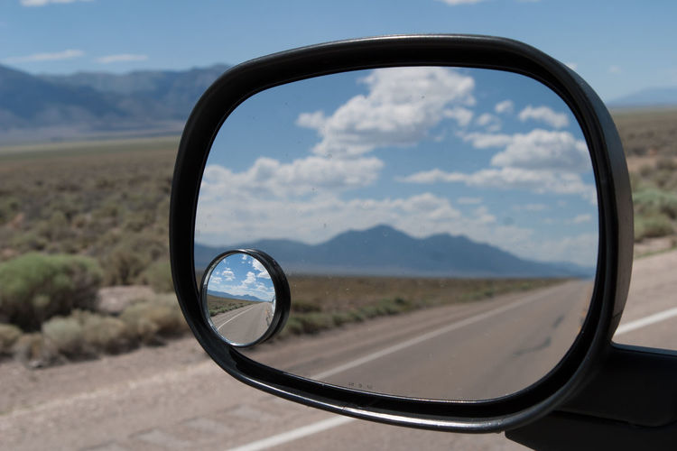 On the road to Utah America Americana Car Desert Highway Journey Land Vehicle Mirror Mode Of Transport Mountain Range Nevada Personal Perspective Reflection Reflection Road Roadside Roadside America Rural Rural Scene Side-view Mirror Transportation United States USA Utah Wing Mirror