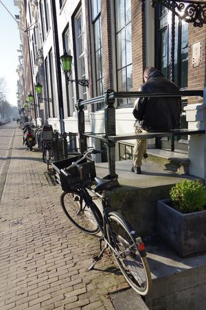 Amsterdam Bicycle City Cycle Parking Day Door Step Outdoors Quiet Time Reading Street Life Sunny Spot