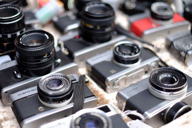 EyeEm Selects Technology Photography Themes Camera - Photographic Equipment Close-up Lens - Optical Instrument Photographic Equipment Retro Styled Camera Still Life Large Group Of Objects Lens - Eye Equipment No People Backgrounds