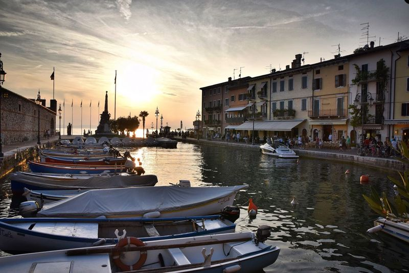 Colour Of Life Europe Trip Tranquil Scene Italia Lake Sunset_collection Landscape Lake Garda Lazise Italy Water Cityscapes Sky Sunset And Clouds  Lago Di Garda EyeEm Best Shots Scenics TOWNSCAPE Travel Tourism Water_collection Boat