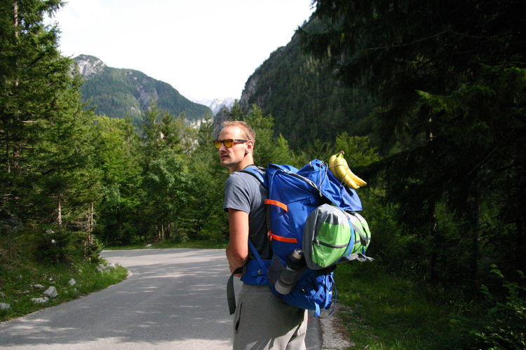 Backpacking Adventure Backpack Challenge Forest Happiness Hiking Mountain Nature On The Road One Person Outdoors Portrait Sports Clothing Travel Destinations Tree