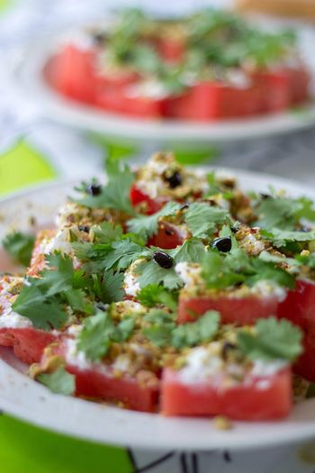 Summer salad. Outdoors Fresh Freshness Watermelonlove Watermelon🍉 Watermelon Peanuts Balsamic Vinegar Coriander Cheese Chevre  Summer Kitchen Food And Drink Food Freshness Ready-to-eat Healthy Eating Wellbeing Plate Fruit Salad Vegetarian Food Herb Close-up