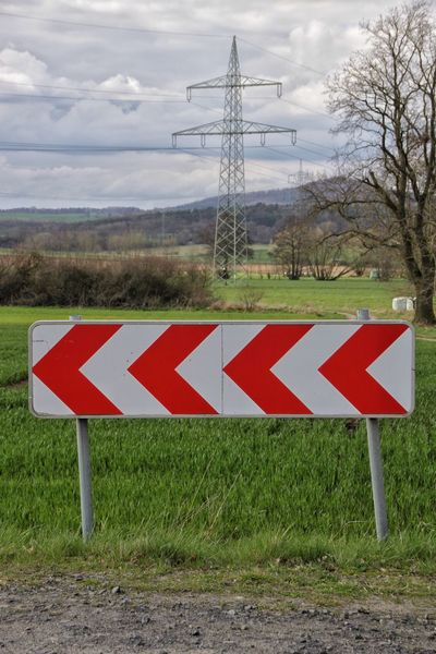 Energiewende Change Cloud - Sky Cloudy Countryside Direction Electricity Pylon Energy Energy Revolution Energy Transition Field Fuel And Power Generation Grass Guidance Information Sign Landscape Nature Outdoors Pole Road Road Sign Rural Scene Sky Solitude Warning Sign