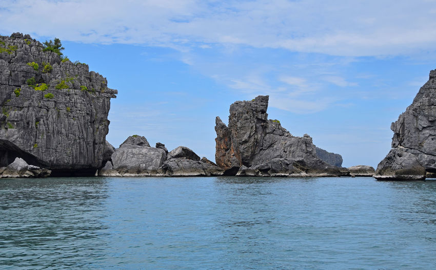Beautifull island cliff rocks of Ang Thong National Marine park of Thailand Ang Thong National Marine Park Angthong Blue Blue Wave Cliff Day Geology Idyllic Island Nature Rock Rock Formation Rocks Rocky Mountains Scenics Sea Sky The KIOMI Collection Tranquil Scene Tranquility Water The Great Outdoors With Adobe