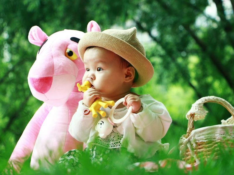Baby Cute Babies Only Pink Color Day Happiness Smiling Nature Sun Hat Outdoors People One Person Full Length Portrait Grass Close-up Tree Adult