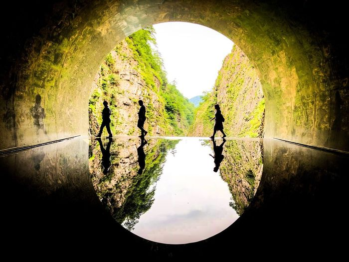 バイストンウェル(Byston Well)に行けそうな。 Tunnel Water Silhouette Nature Reflection Real People Men Architecture Sky Lifestyles Tree Leisure Activity Plant Arch Togetherness Day Outdoors People Group Of People