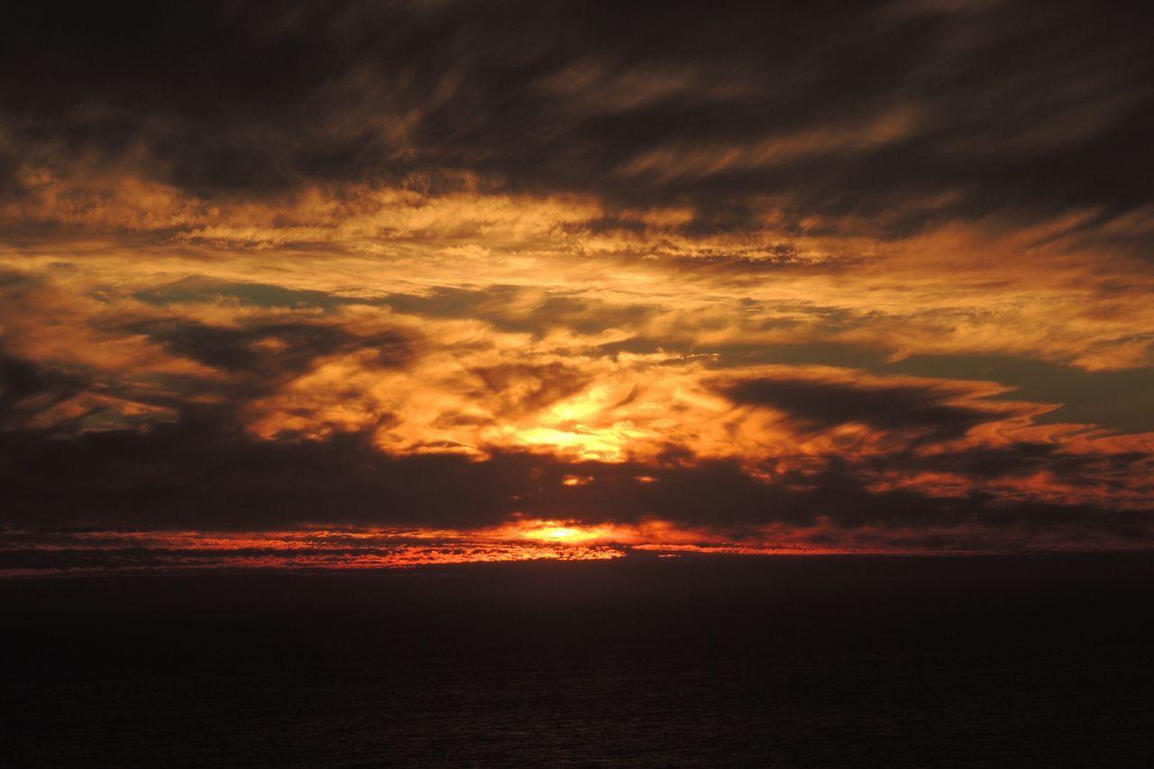 sunset, beauty in nature, scenics, nature, sky, tranquility, tranquil scene, orange color, cloud - sky, dramatic sky, idyllic, no people, silhouette, sea, sun, outdoors
