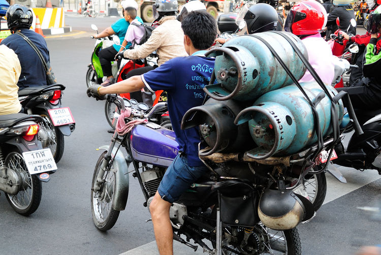 Man Carrying Gas Cylinders On Motorcycle