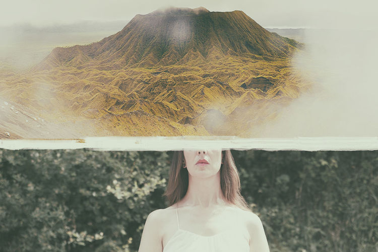 Portrait of woman standing on mountain