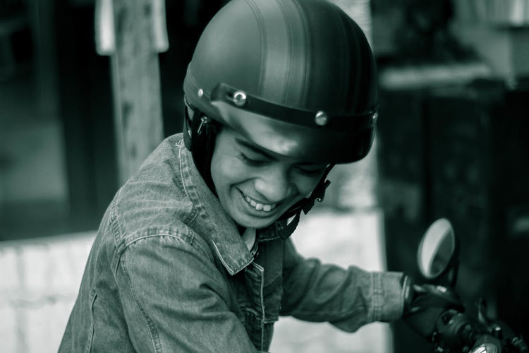 Smiling man sitting on motorcycle