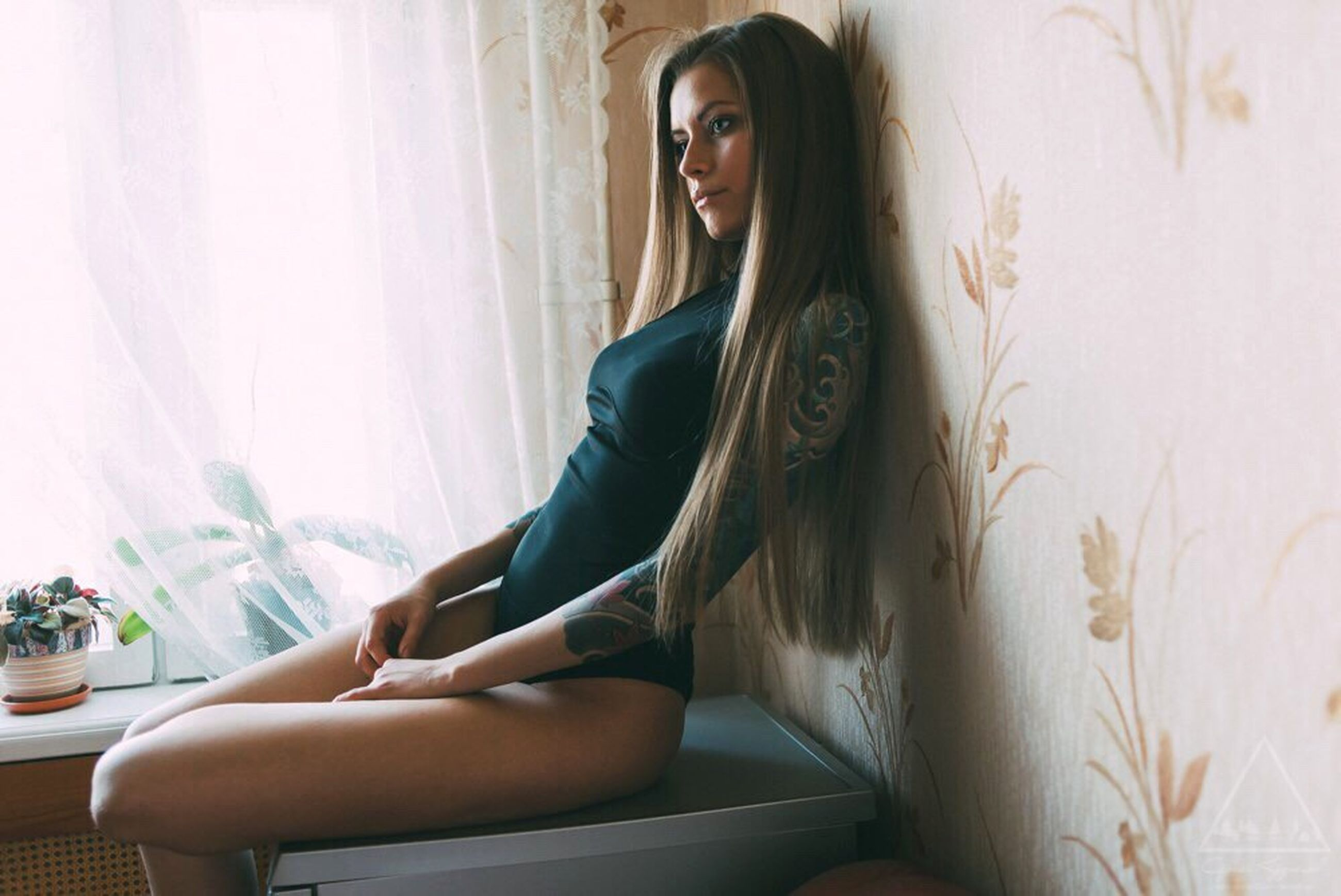young adult, young women, indoors, sensuality, long hair, person, lifestyles, femininity, beauty, casual clothing, fashion, front view, seduction, portrait, looking at camera, home interior, seductive women