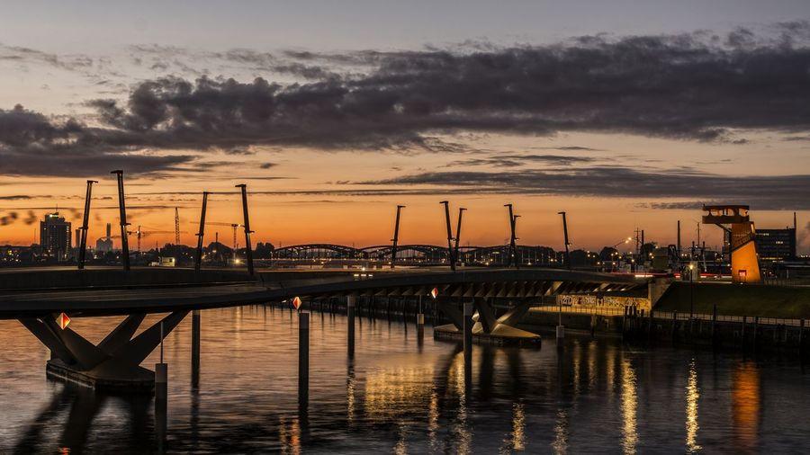 Bridge over elbe river during sunset