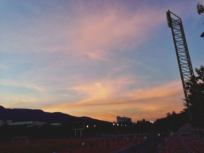 Cloud - Sky Outdoors Sky Sunset Sport Social Issues Mountain Nature Stadium Sports Venue No People Architecture Day
