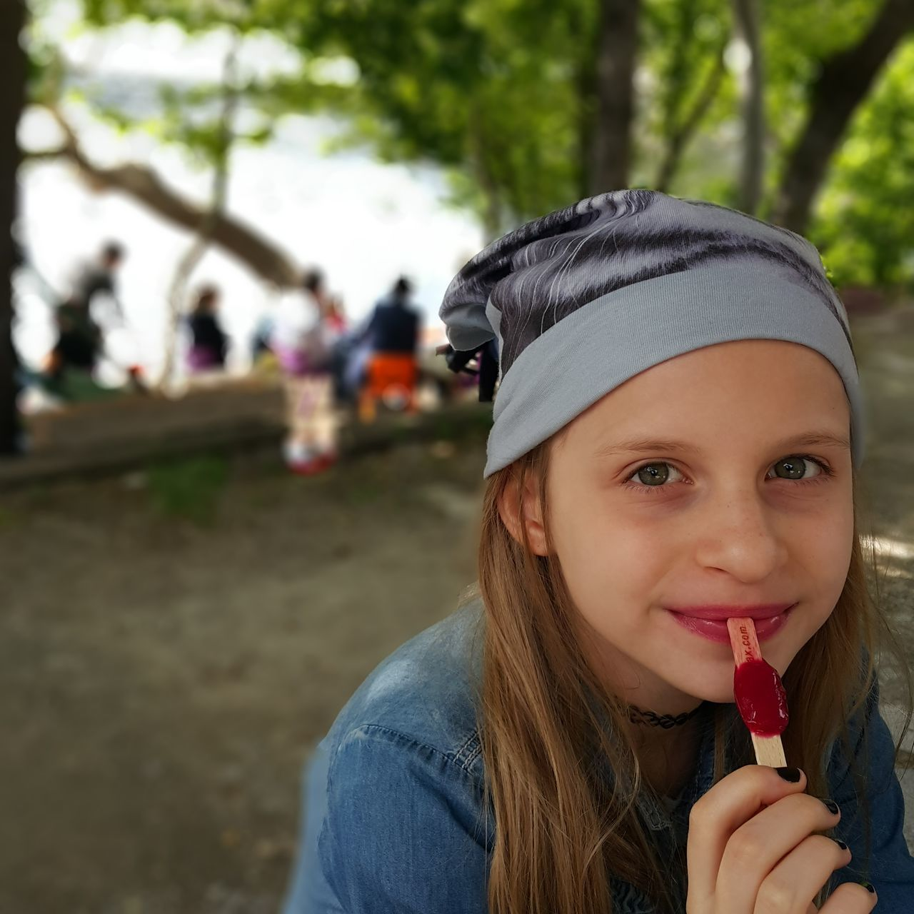 Portrait Of Girl Eating Popsicle