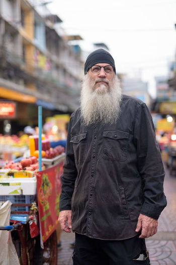 Man standing at market in city
