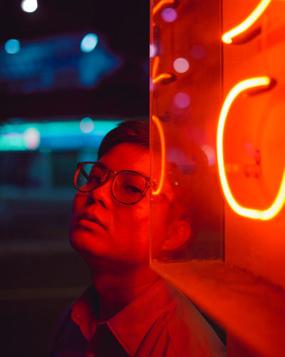 yoke ming Neon Lights Portrait Portrait Photography Portrait Of A Man  Red Neon Red Light Looking At Camera Illuminated Technology Neon Red Close-up Posing Head And Shoulders