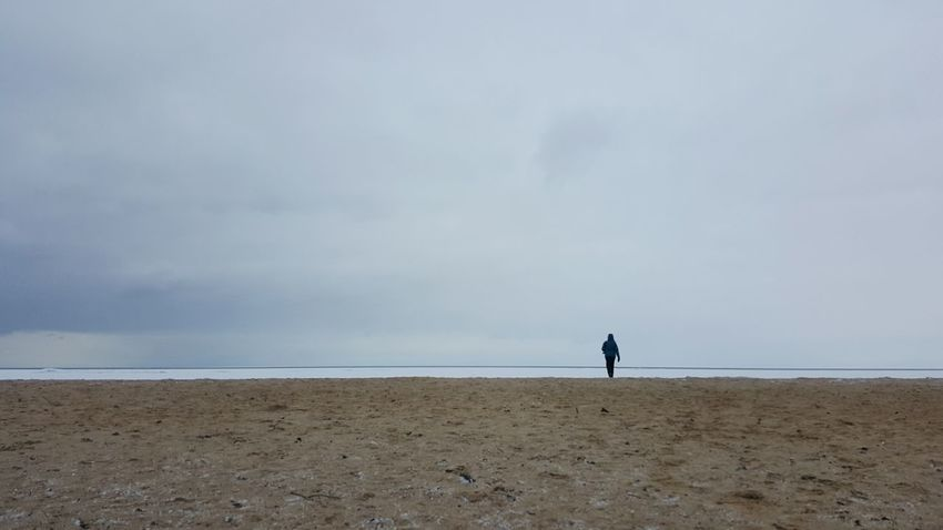 Beach Horizon Over Water Sand Lake Huron Great Lake Winter Beach One Person Storm Cloud Full Length Water Silhouette One Peron In The Distance Vastness Nature Adult Sky Sand Sea And Sky Cloudy Day Winter Day Cold Temperature Walking Person Walking