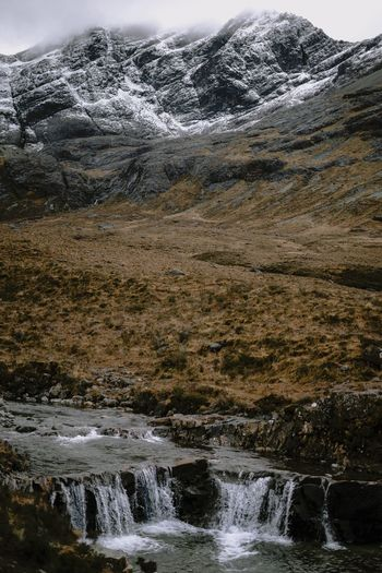Fairy pools Mountain Moody Sky Moody Weather Scotland Water Nature No People Beauty In Nature Scenics - Nature Day Motion Waterfront Non-urban Scene Tranquility Splashing Outdoors Cold Temperature Tranquil Scene Environment Land Reflection Close-up Flowing Water Flowing