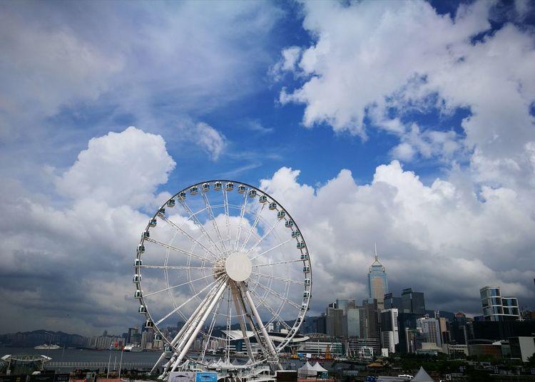 Ferris Wheel Against Buildings In City