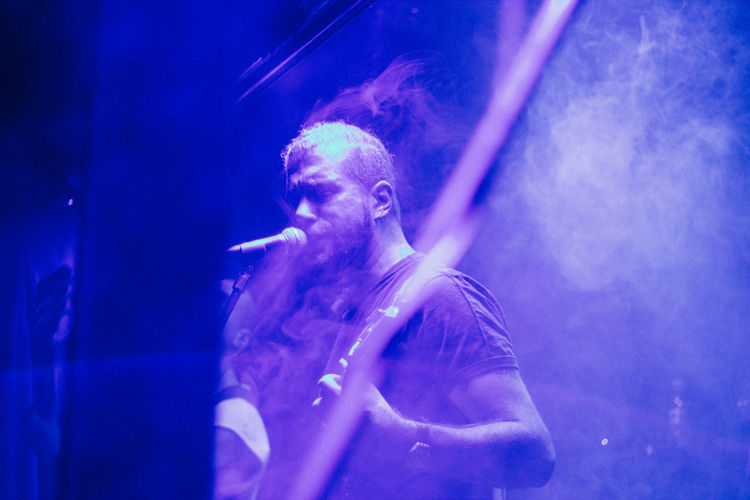 Arts Culture And Entertainment Blue Canon Canonphotography Enjoyment Glowing Guitar Guitarist Istanbul Istanbuldayasam Leisure Activity Lifestyles Light Men Metal Metal Music Music Performance Real People Rock Singing Smoke Stage VSCO Vscofilm