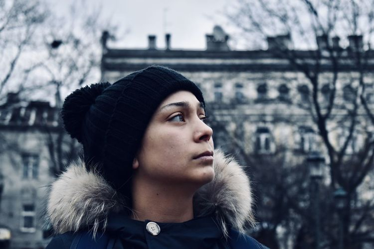 Portrait of young woman looking away during winter