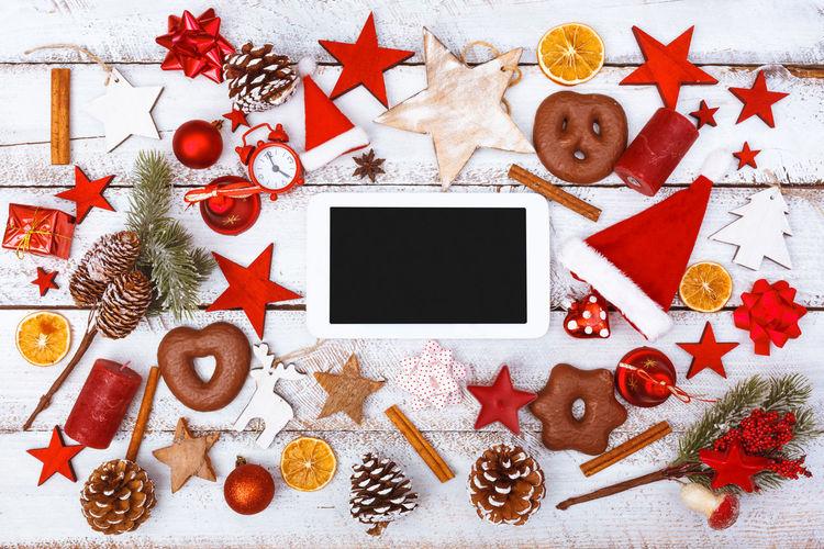 High Angle View Of Tablet Computer Christmas Decoration On Table