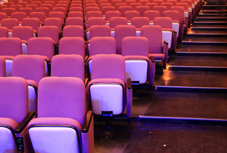 High angle view of empty chairs in auditorium
