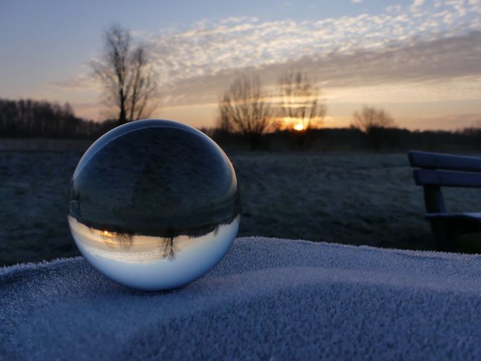 Lensball Lensball Sunset Cold Temperature Winter No People Snow Dusk Bare Tree Sky Outdoors Nature Tree Frozen Landscape Close-up Beauty In Nature