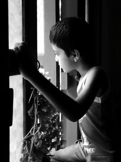 Side view of boy looking at home