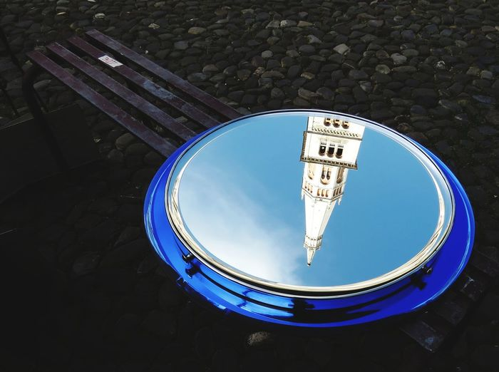 Antique market in Piazza Grande - Modena. Ghirlandina tower reflection in a mirror on a bench Street Tower Church Antique Market Bench Blue Blu Reflect Reflection Mirror Close-up Cityscape Circle Urban Scene Street Market