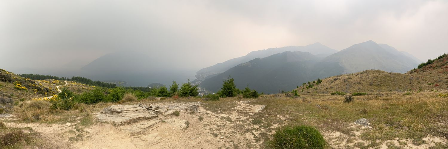 Panoramic view of land and mountains against sky
