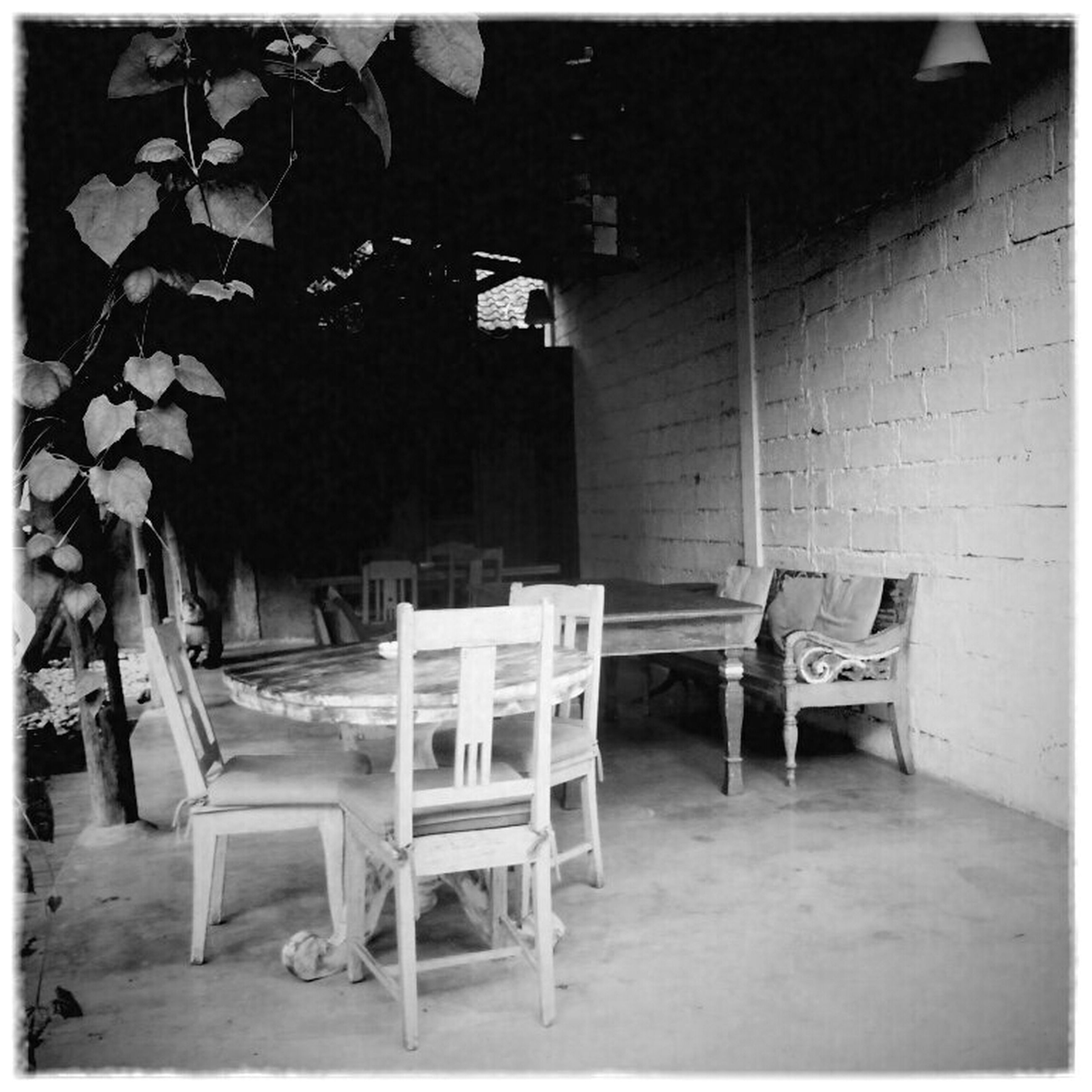 chair, empty, absence, transfer print, table, indoors, architecture, auto post production filter, built structure, seat, house, furniture, building exterior, no people, day, sunlight, window, bench, abandoned, sidewalk cafe