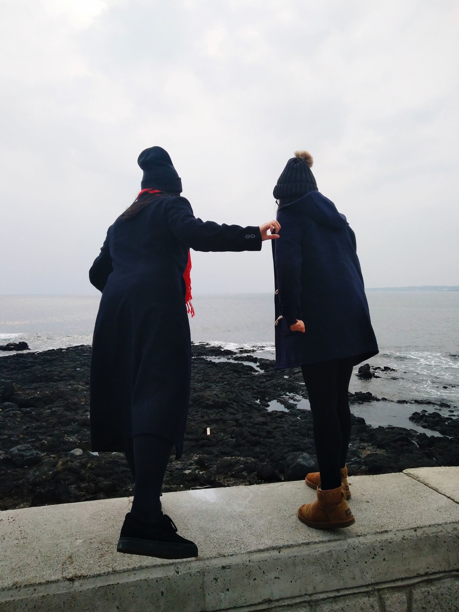 two people, love, togetherness, bonding, rear view, sea, outdoors, sky, men, standing, adults only, warm clothing, beach, day, real people, water, leisure activity, full length, people, adult, women, vacations, nature, only men