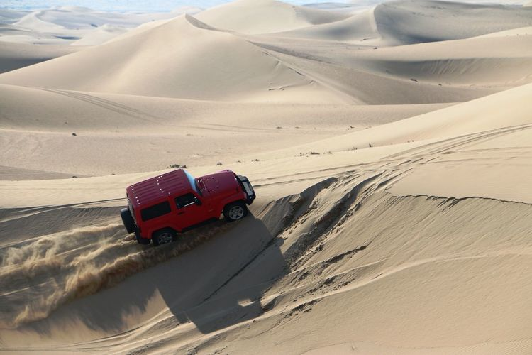 High Angle View Of Off-Road Vehicle At Desert