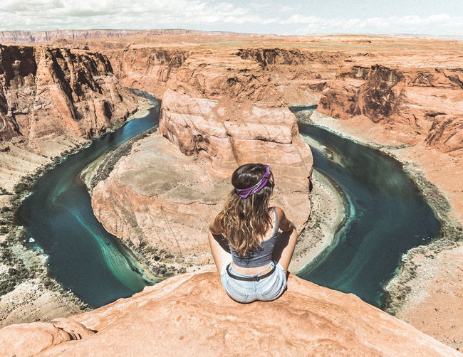Rear view of woman at horseshoe bend