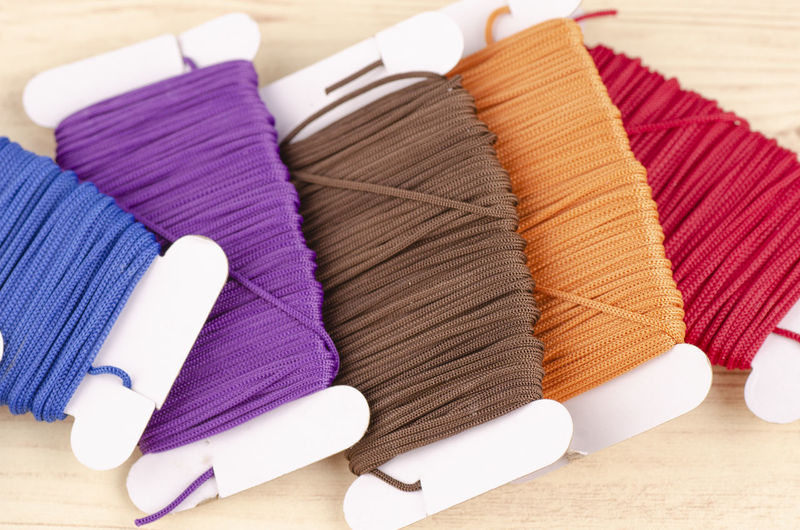 colorful stacking cotton yarn wool Indoors  Multi Colored Choice Textile Still Life No People Close-up Table Large Group Of Objects Variation Art And Craft Focus On Foreground Group Of Objects Collection Arrangement Stack Thread In A Row Creativity High Angle View Purple