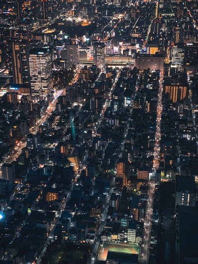 High angle view of city lit up at night in tokyo japan