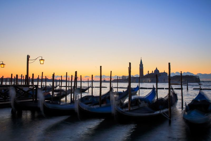 Good morning Venice Moving Tourism Waterways Adriatic Sea Veneto Region Venezia Tourist Attraction  Benatky Venice, Italy Canals Lagoon Grand Canal Sky Water Nautical Vessel Moored Mode Of Transportation Transportation Clear Sky Nature No People Wooden Post Waterfront Travel Destinations Sea Gondola - Traditional Boat