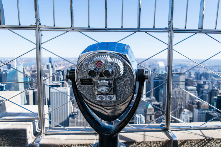 Coin-Operated Binoculars With Cityscape In Background
