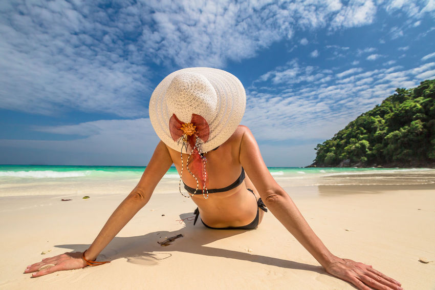 Back of happy and fashionable tourist woman with colorful sarong in turquoise water of Maya Bay famous lagoon of The Beach movie, Phi Phi Leh, Andaman Sea in Thailand Fashionable and happy tourist with sarong and pink wide-brimmed hat making a selfie on tropical famous beach of Nai Harn Beach, Rawai, Phuket, Thailand. Happy tourist enjoys panorama from Sail Rock View Point of kor 8 of Similan Islands National Park, Phang Nga, Thailand, one of the tourist attraction of the Andaman Sea. Happy woman with bikini and shorts, jumping in the air on Ya Nui Beach, a little cove divided by a rocky cape, Phuket, Thailand, Asia. Happy Koh Rok Islands Nui Beach Phang Nga Bay Phuket Thailand Tanning ☀ Thailand Vacations Woman Beach Beauty In Nature Bikini Day Girl Hat Koh Rok Leisure Activity Lifestyles Nature One Person Outdoors Phang Nga Rawai Real People Sand Scenics Sea Seascape Shadow Shore Sky Summer Sun Hat Sunlight Surin Islands Tranquil Scene Travel Destinations Vacations Water Young Adult Young Women