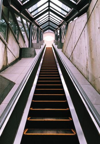 Upward view of empty escalator. going on and on.